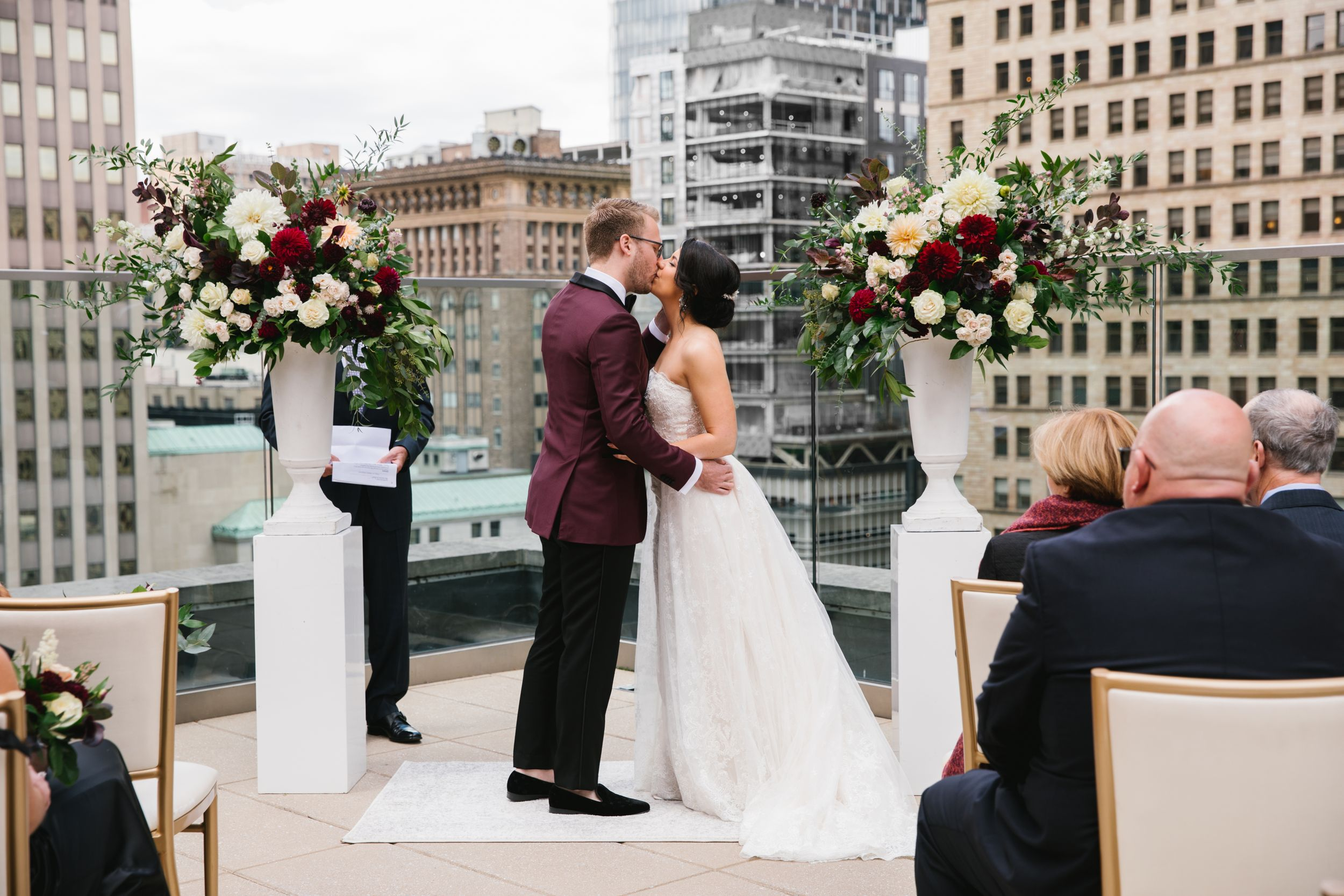 first kiss as husband and wife during rooftop ceremony in toronto ontario city wedding