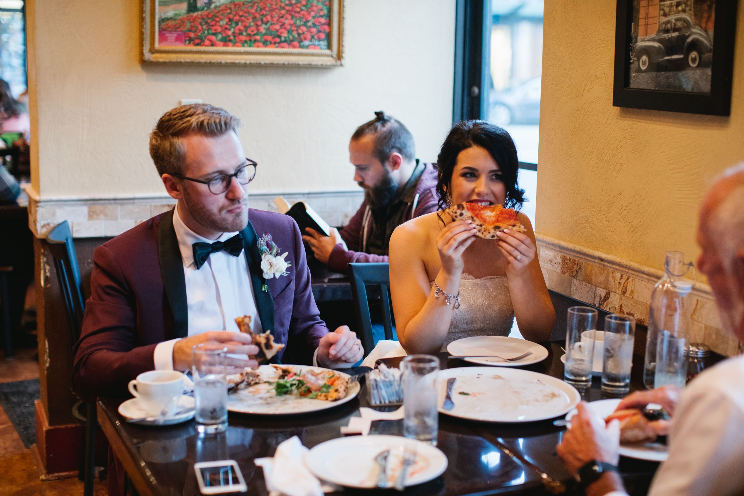 pizza wedding bride eating and laughing