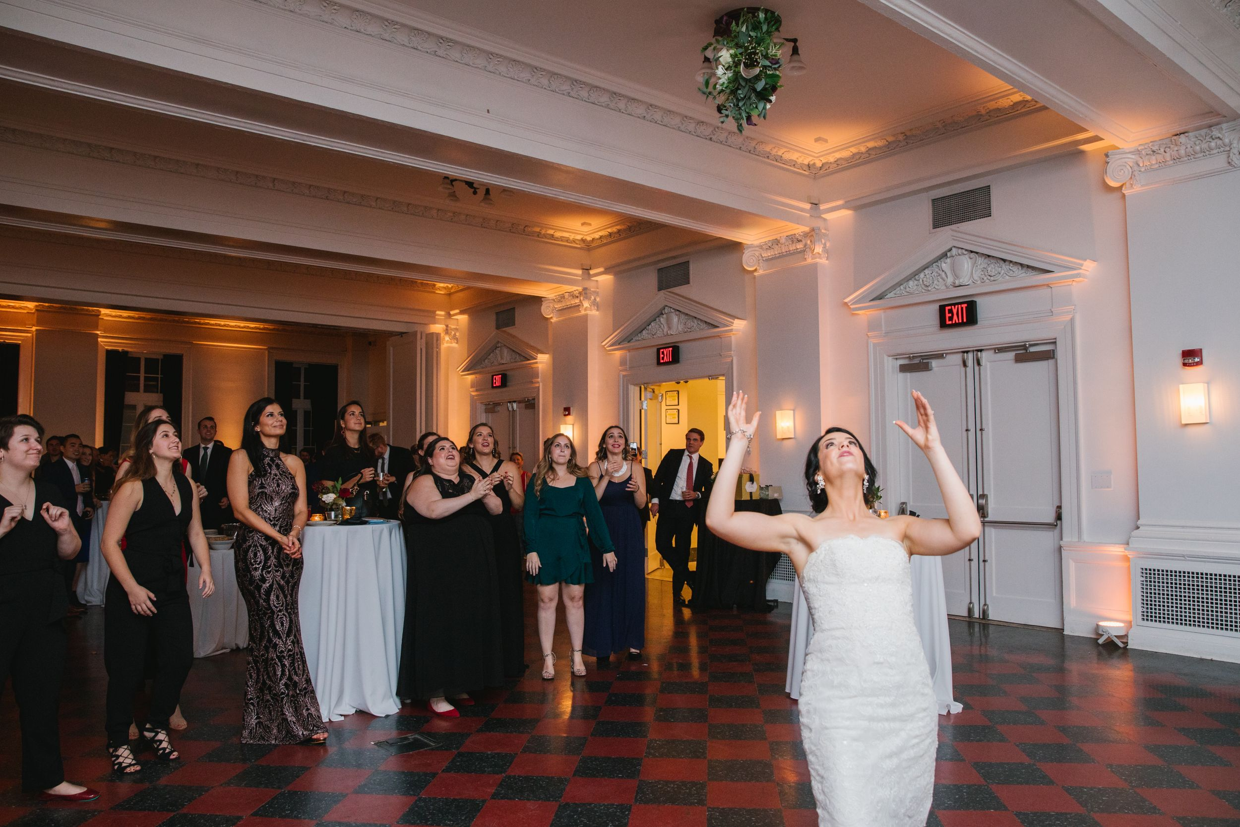 bride throwing bouquet during reception at ace hotel pittsburgh