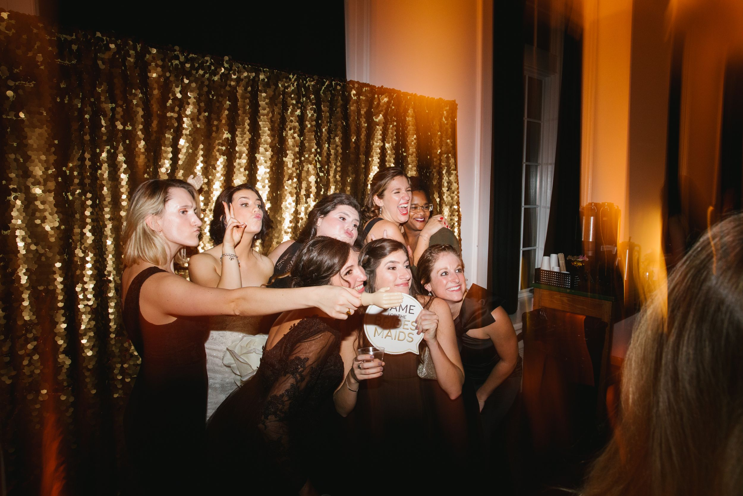 girls posing for photo booth during wedding reception toronto