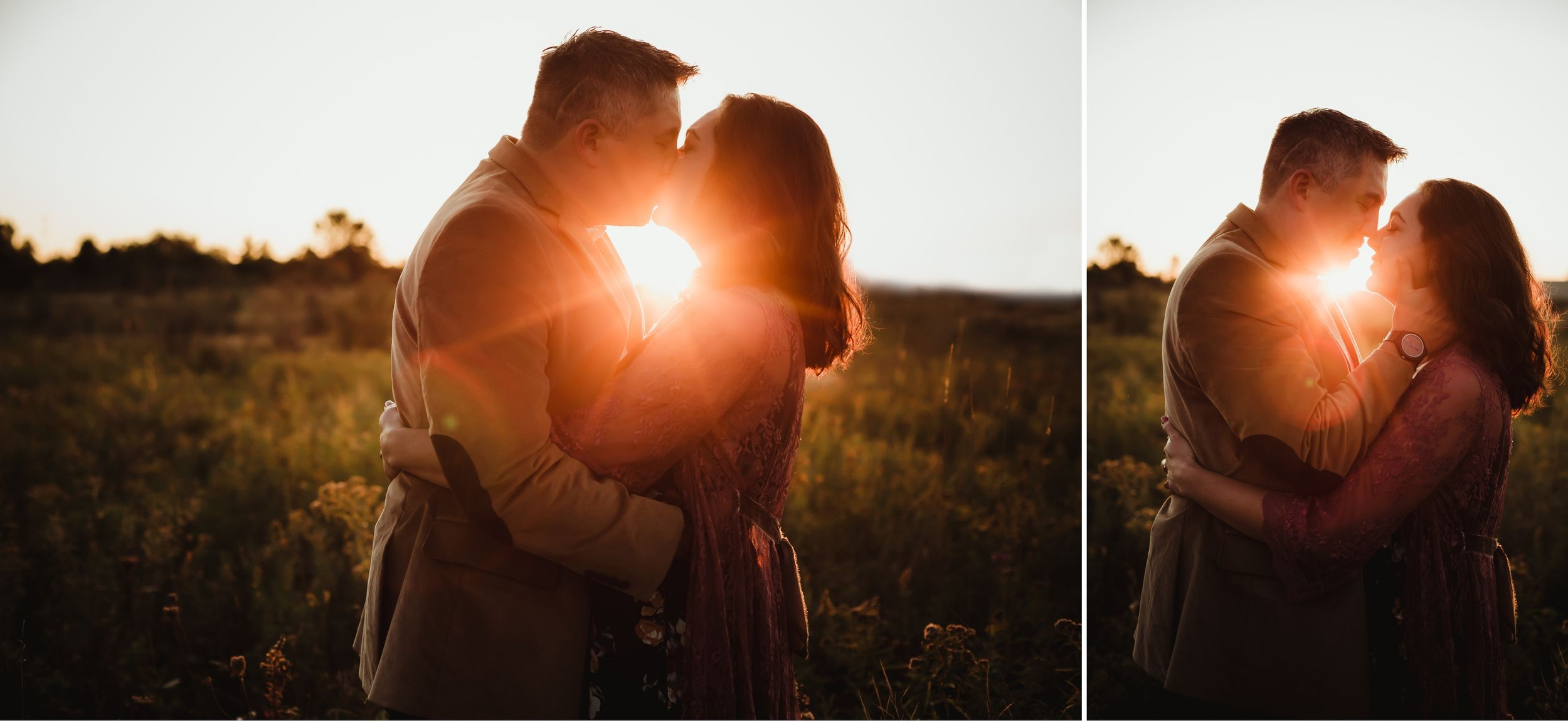 Husband and wife embracing and kissing with a golden sun flare between them.