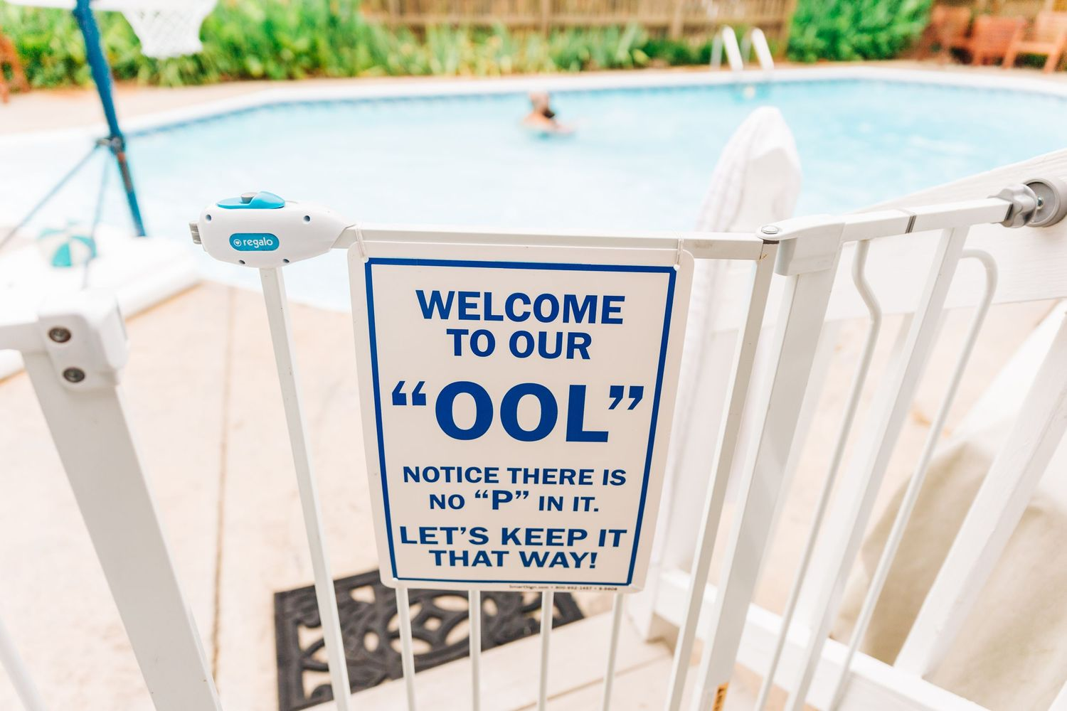 Funny pool sign in Charlotte, NC backyard