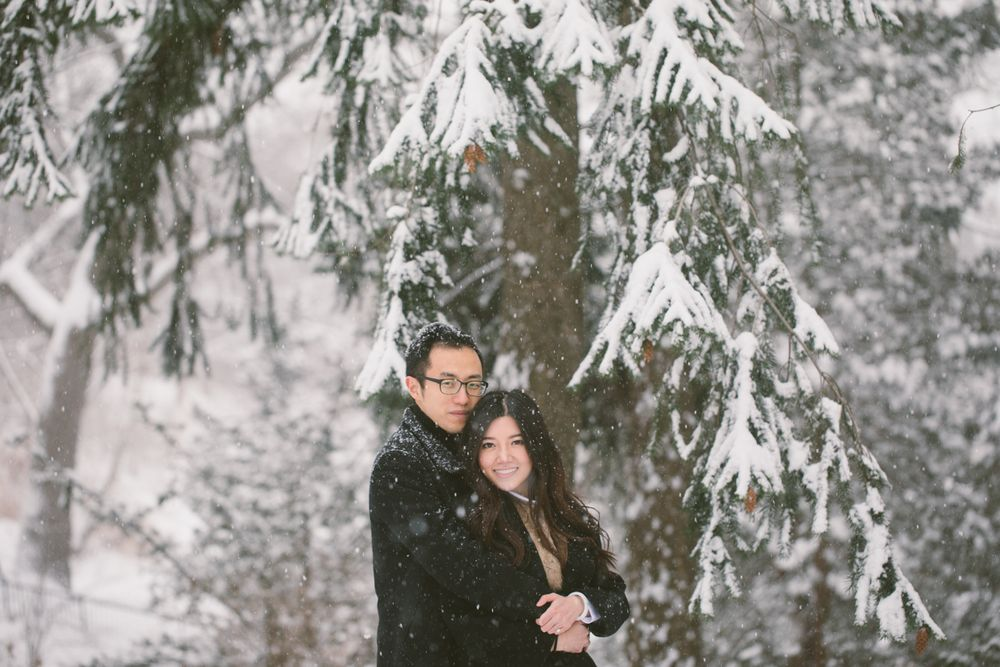 High Park winter engagement session couple hugging