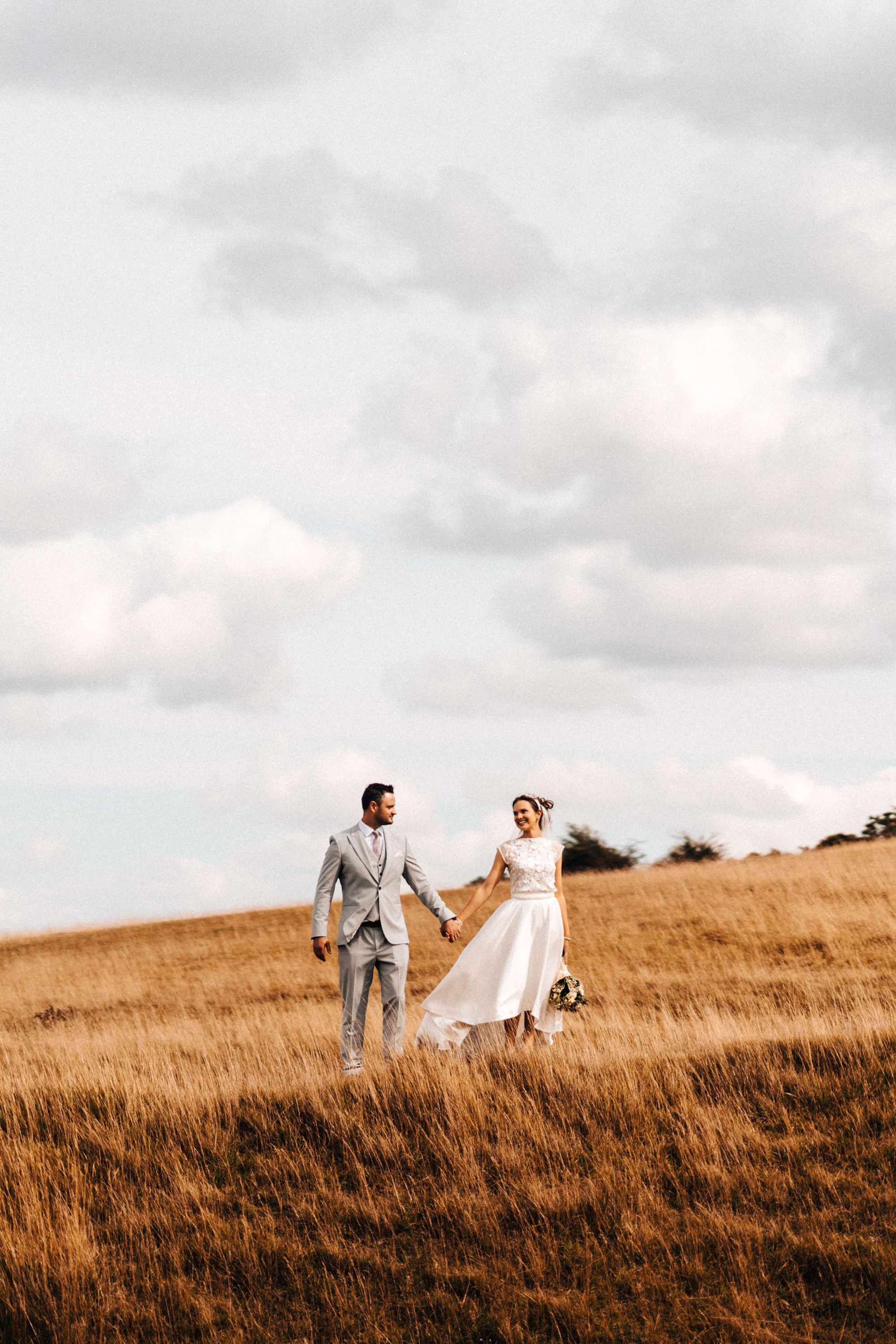 Modern autistic wedding photography at Cleeve Common Cheltenham bride and groom holding hands and licking each other bea