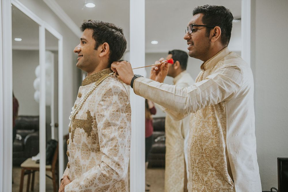 rebecca skidgel photography garre winery indian wedding california groom getting ready groomsmen helping