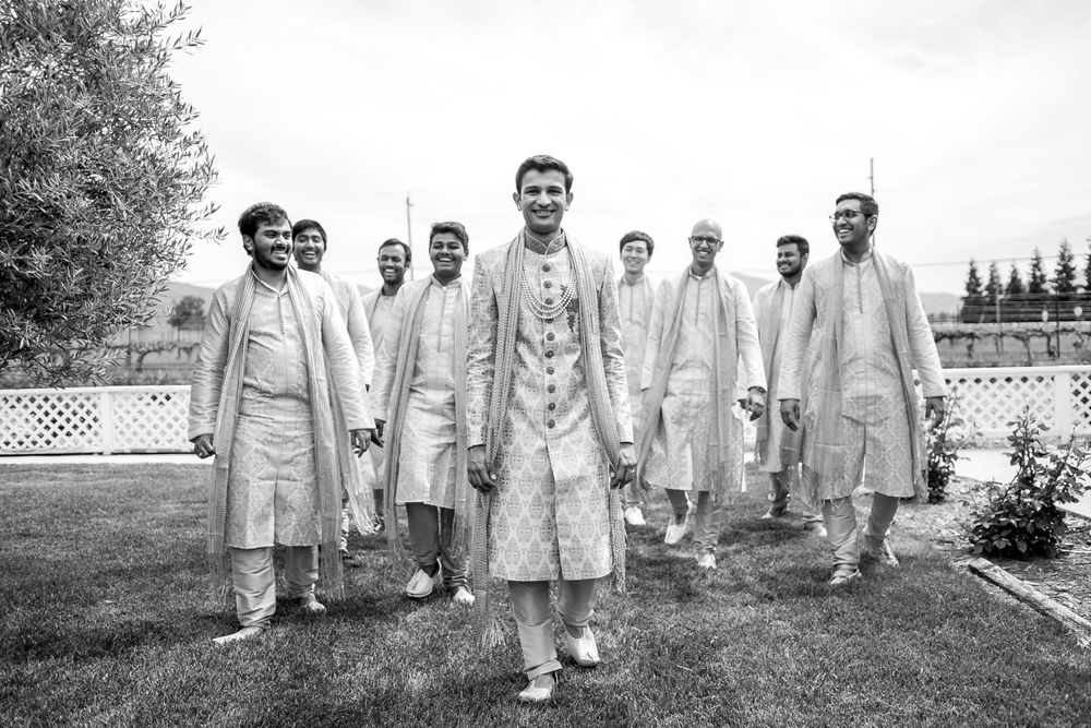rebecca skidgel photography garre winery indian wedding california groom and groomsmen walking and smiling