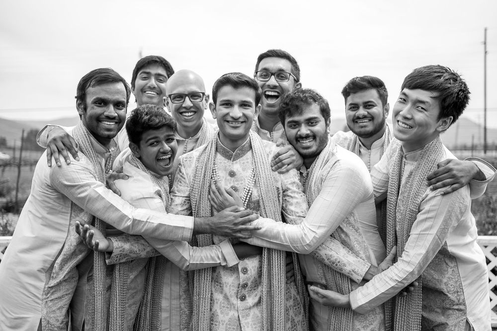 rebecca skidgel photography garre winery indian wedding california groom and groomsmen group hug