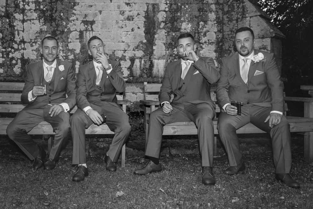 blaqck and white image of the groomsmen.