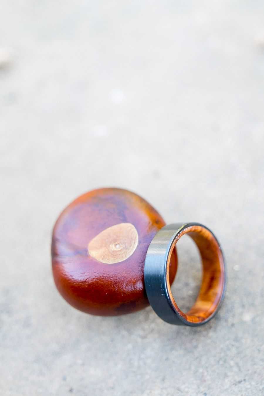 wedding ring with wood interior next to a buckeye