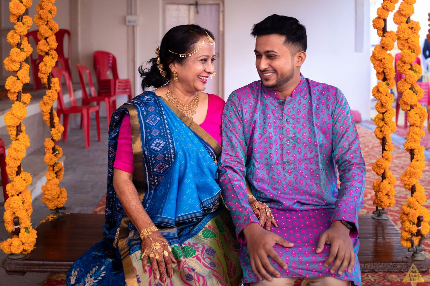 Groom sharing candid moment with mother at his destination wedding