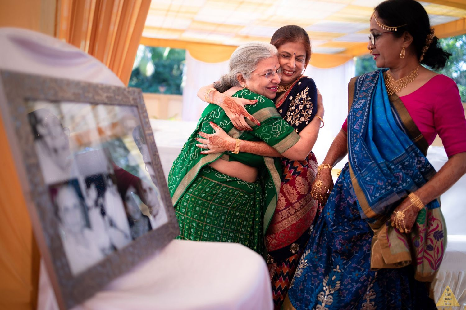 Relatives hugging each other at a destination wedding ceremony