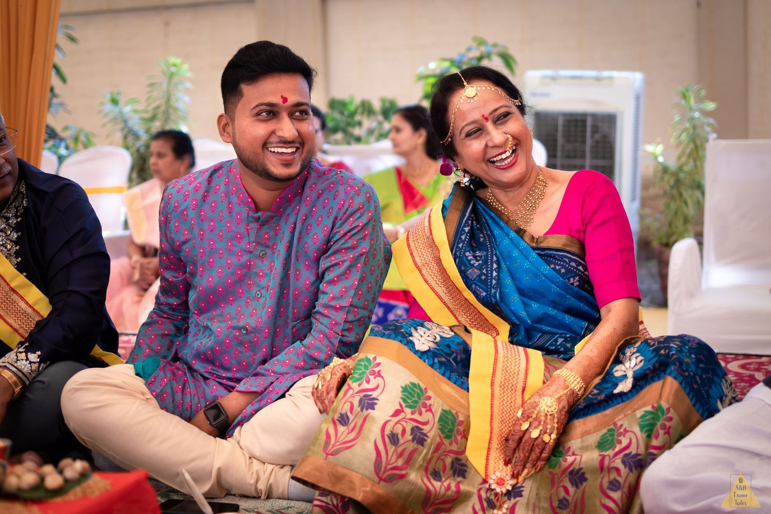 Groom and his mother sharing candid moments at haldi ceremony