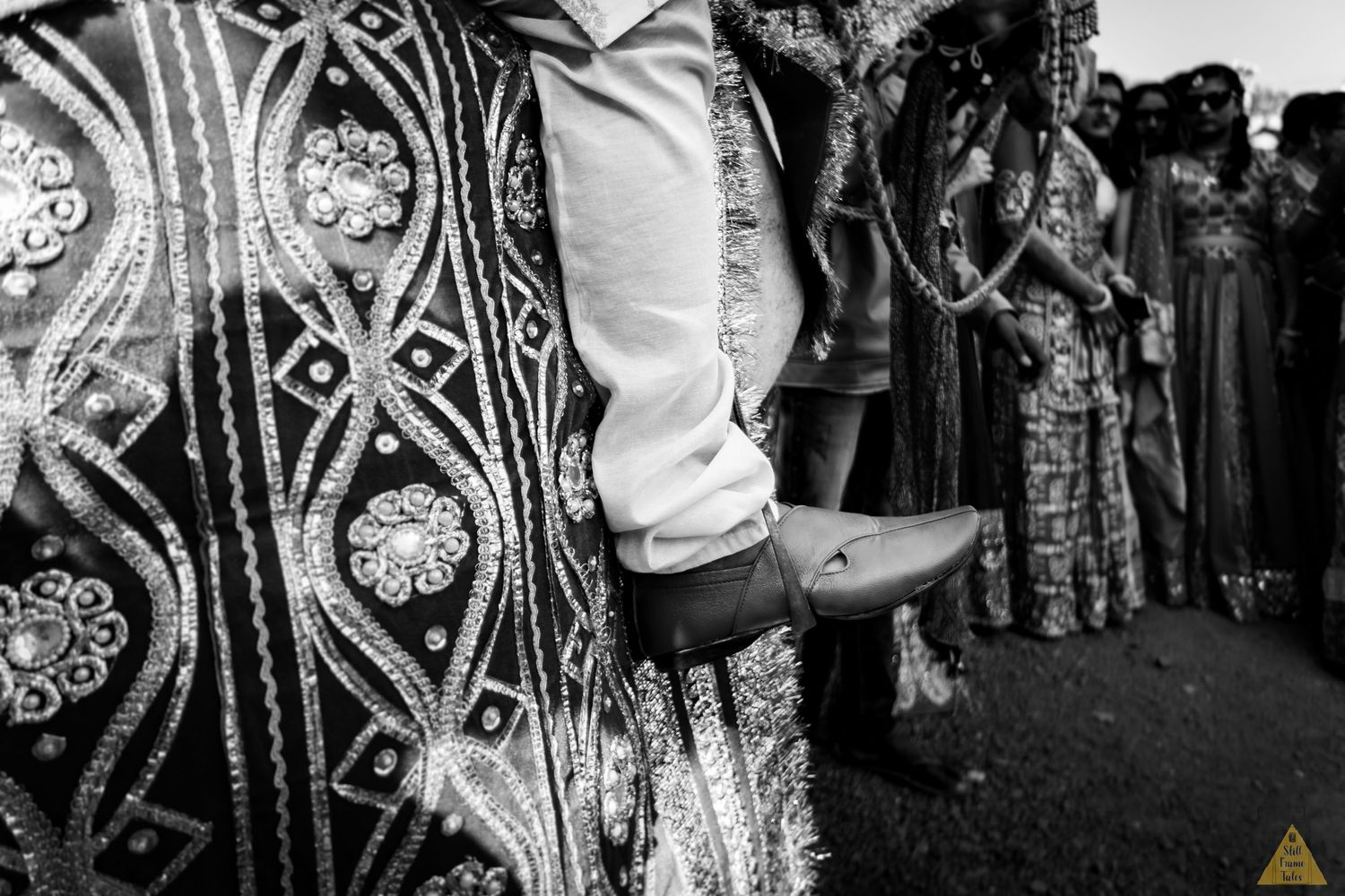 Groom's foot details while riding a horse at a wedding day barat
