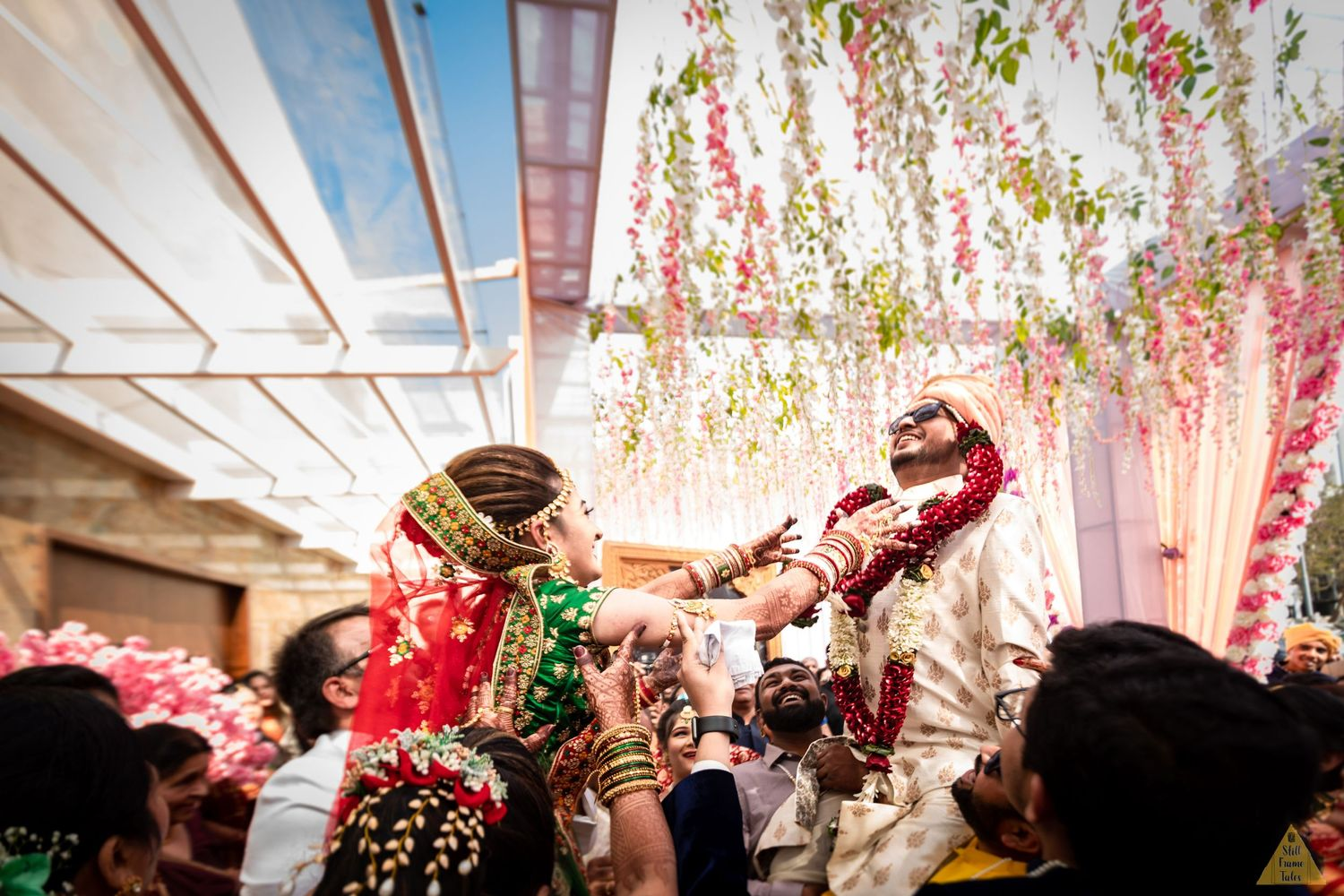 Bride & Groom enjoying varmala ritual with friends and family on a destination wedding