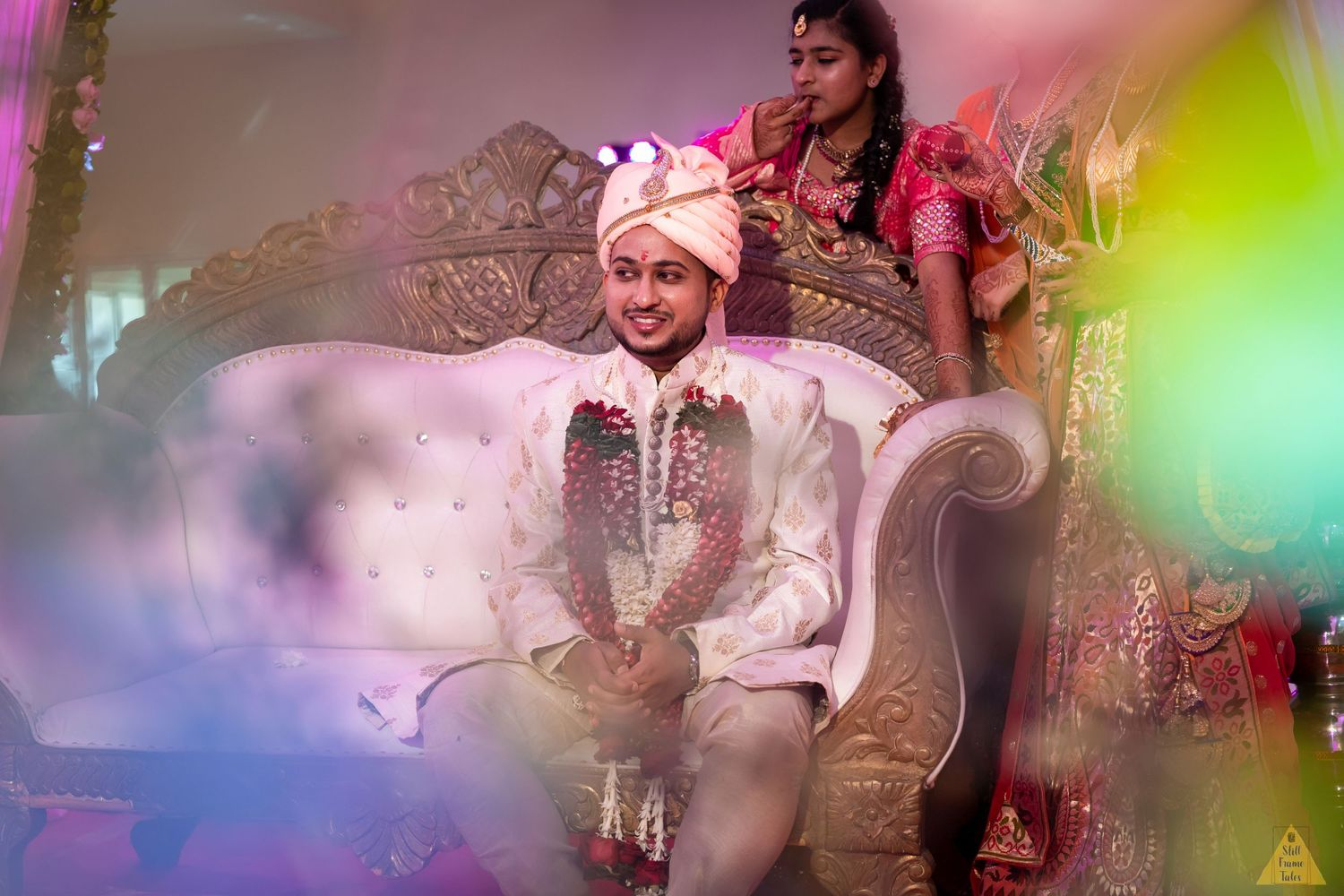 Candid picture of groom with green background in a destination wedding mandap