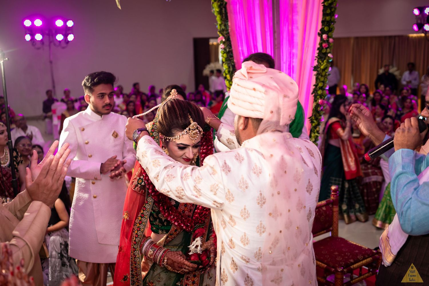 Groom putting a varmala in bride's neck for a destination wedding ceremony