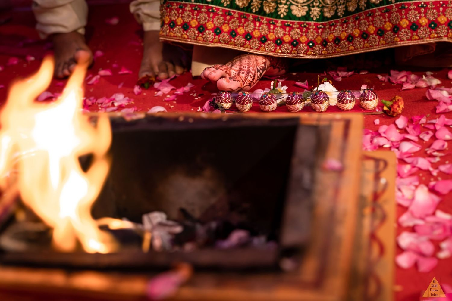 Bride's foot detail whiles performing wedding ritual beside home fire