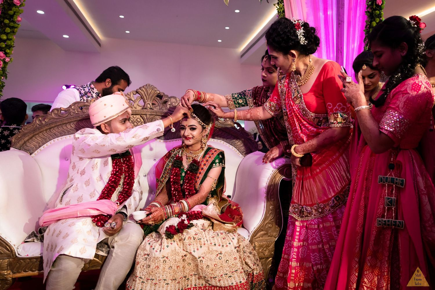 Groom putting a sindoor over bride's forehead at a destination wedding