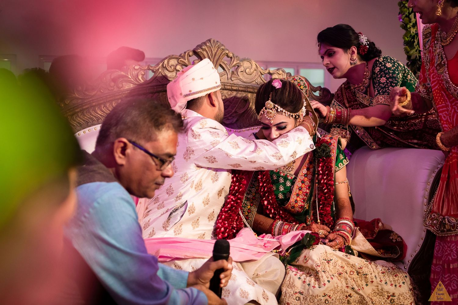 Groom helping bride to wear a mangalsutra at a destination wedding