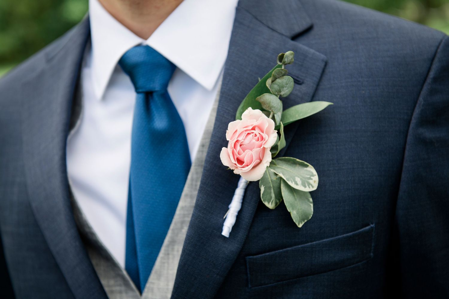 groom's boutonniere at backyard farm wedding