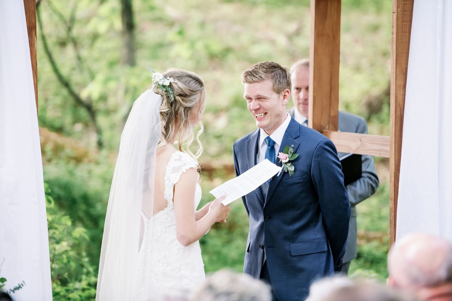 groom's reaction to bride's vows during their backyard farm wedding in woods