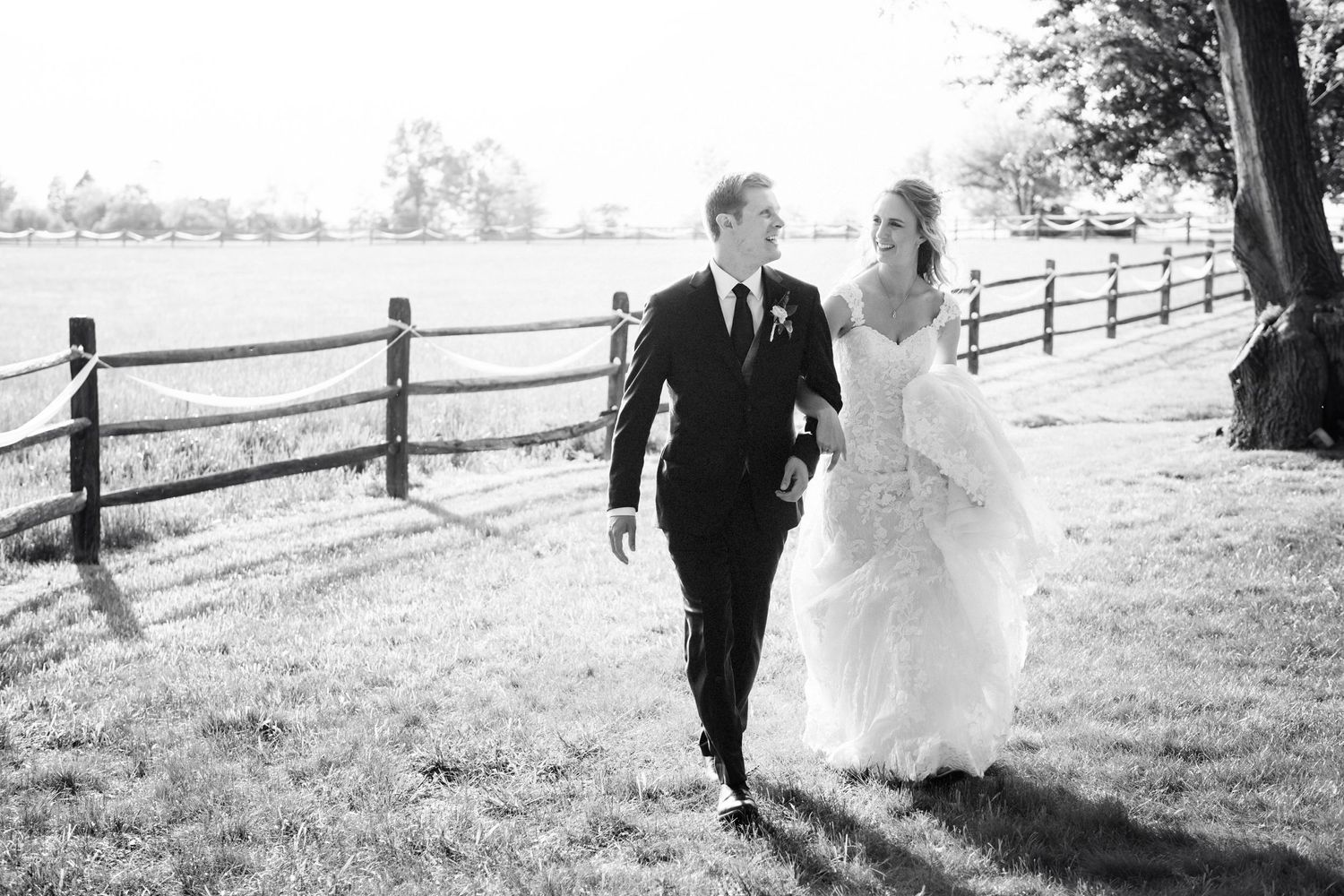 bride and groom walking after backyard farm wedding