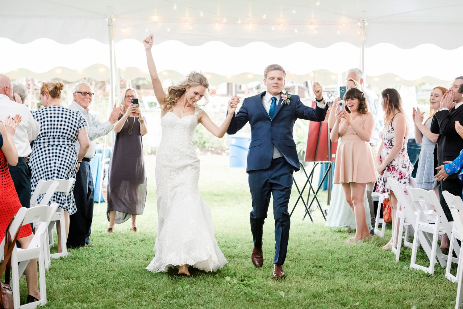 bride and groom enter reception at backyard farm wedding