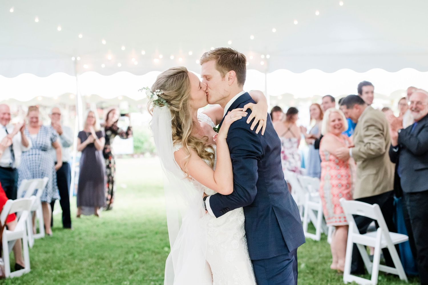 bride and groom kiss during their first dance at backyard farm wedding