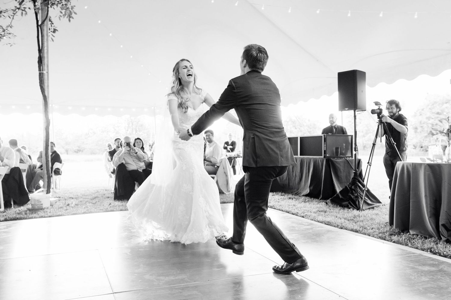 bride dancing during their first dance at backyard farm wedding