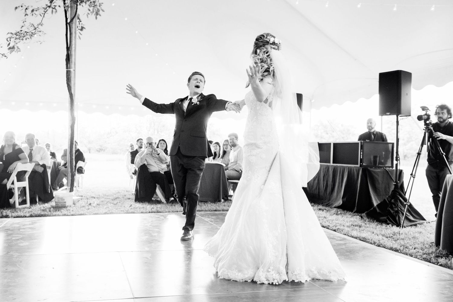 groom dancing their first dance at backyard farm wedding