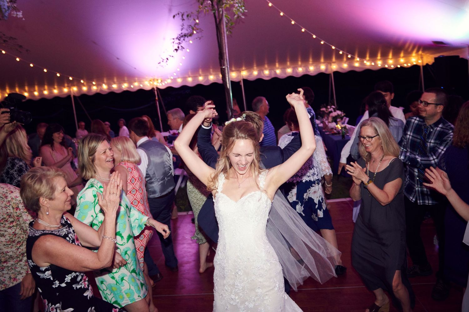 bride dancing during reception at backyard farm wedding