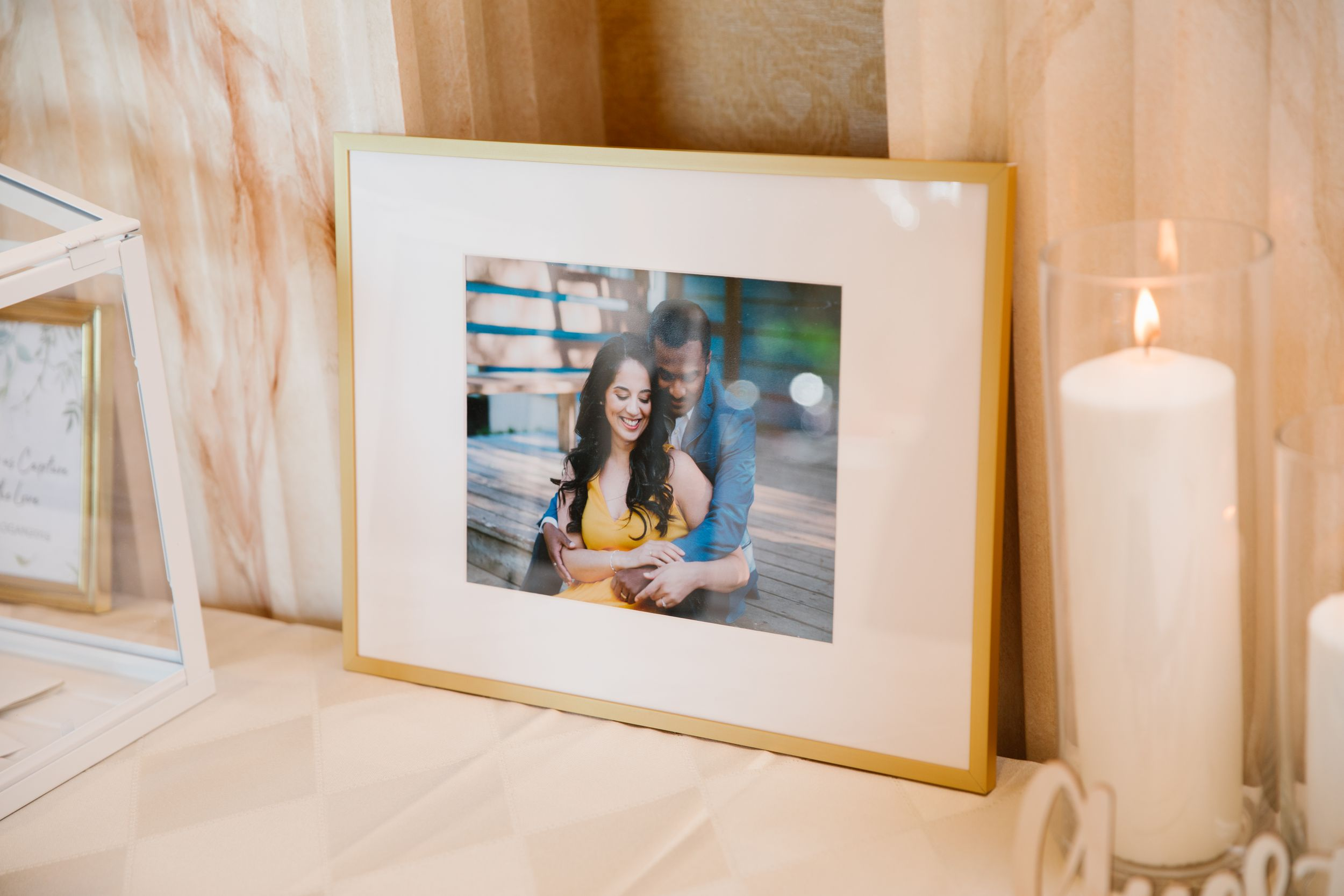 gold framed photo of a couple