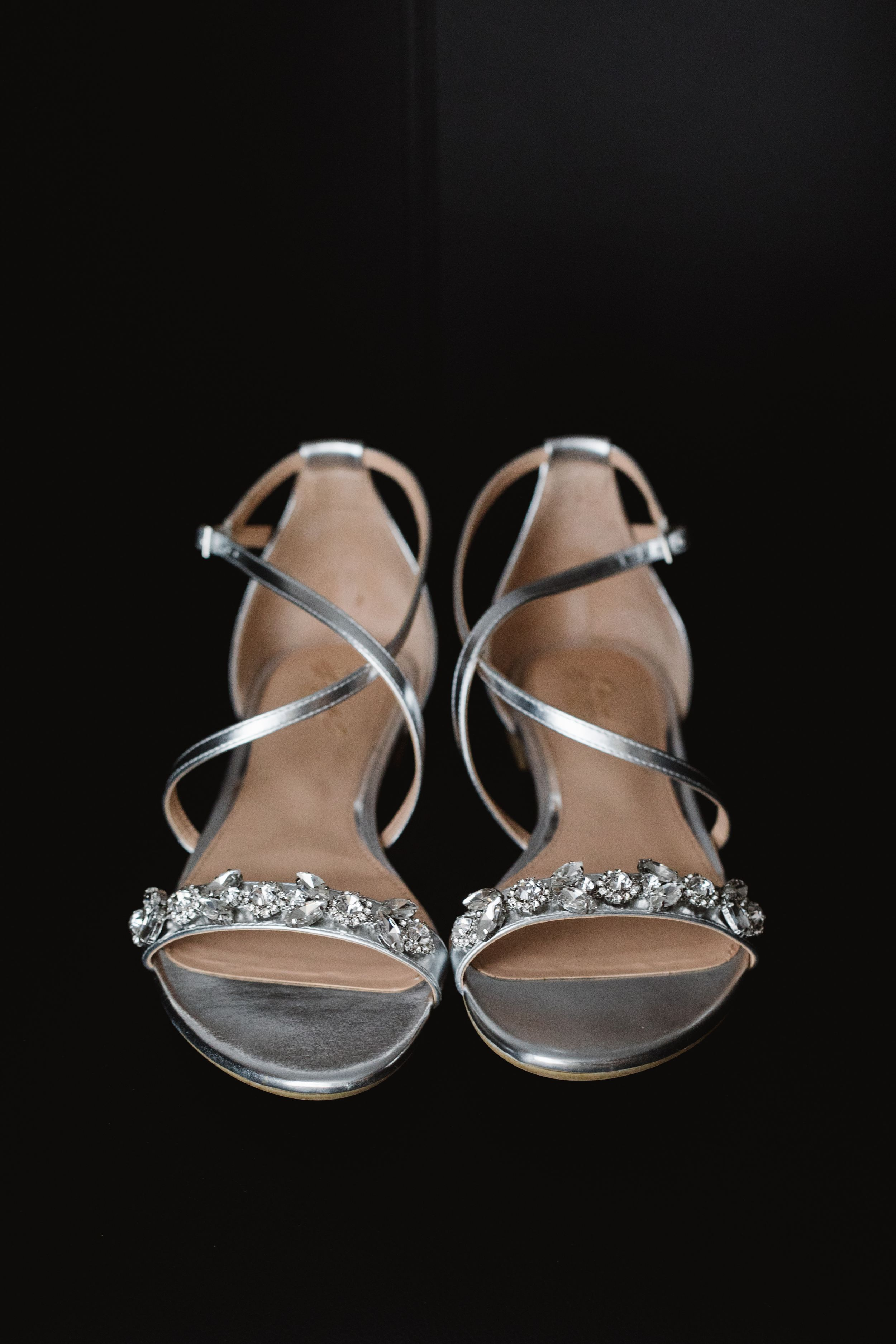 close up flat silver wedding shoes
