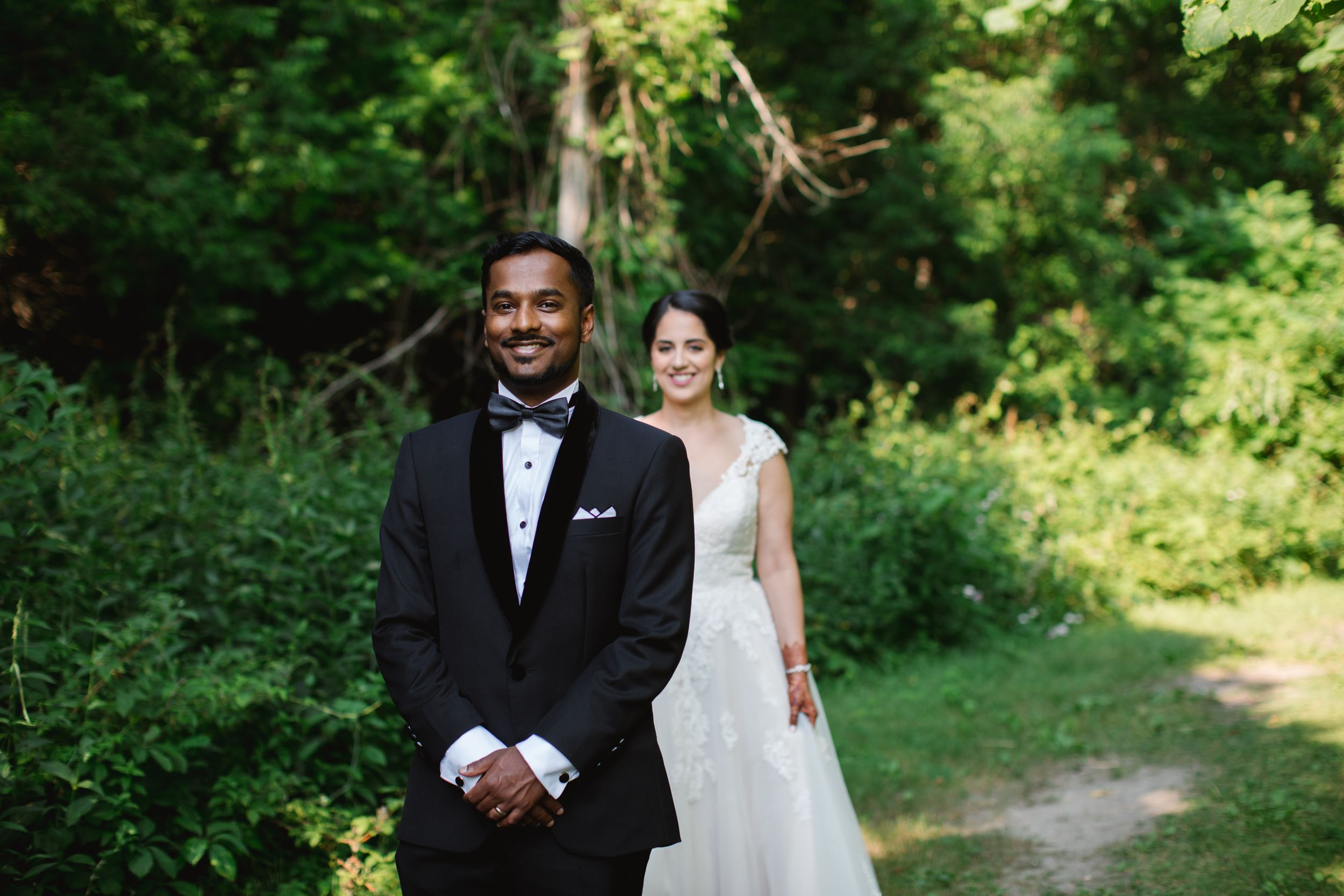 bride walking behind groom for first look at rouge park in toronto