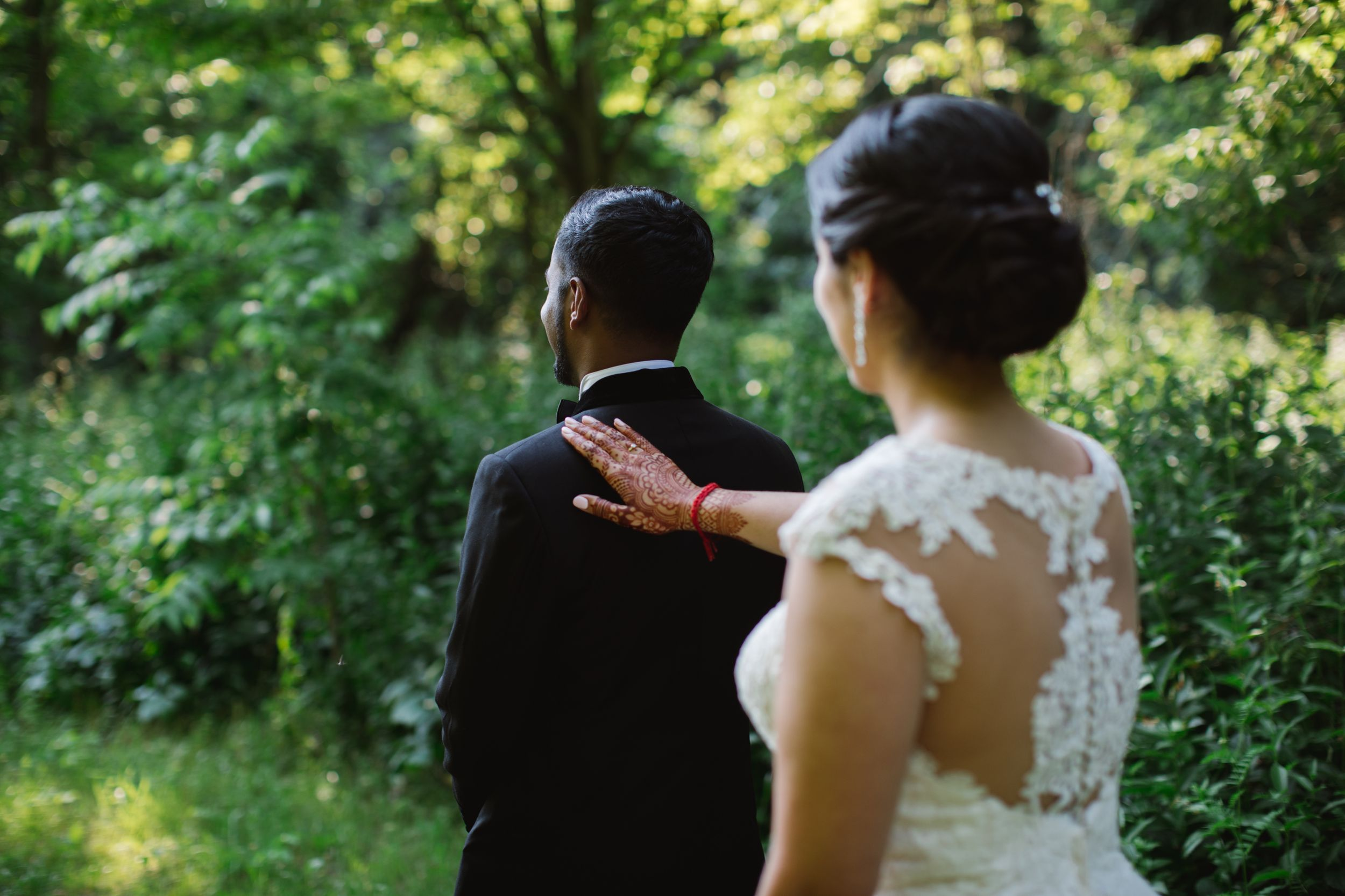 bride tapping groom on the shoulder for first look at rouge park