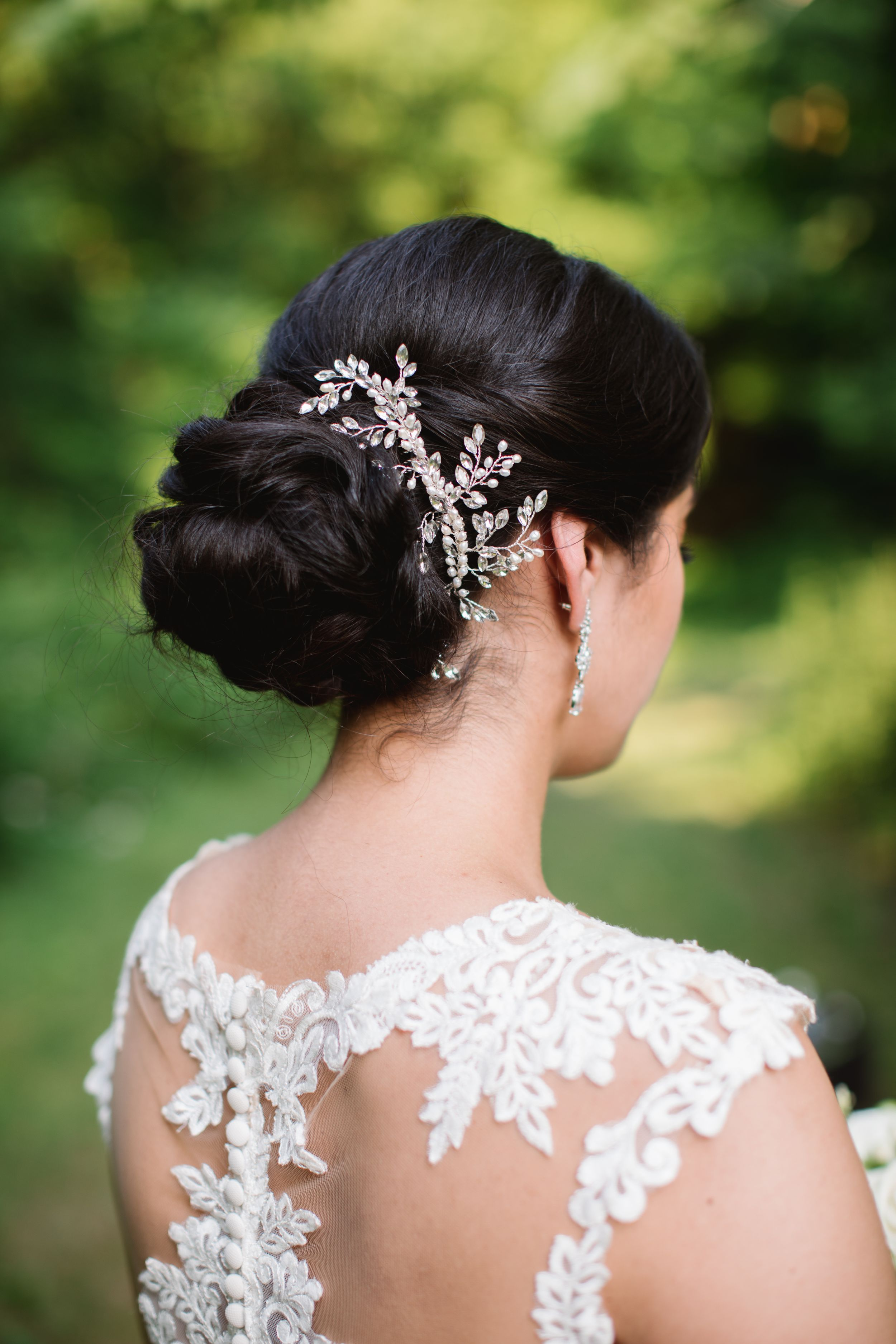 bridal hair style with decoration and a sheer lace wedding dress back