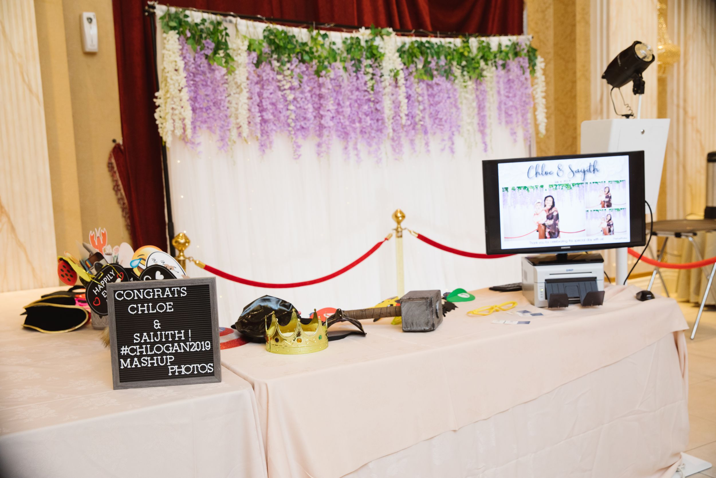 photo booth set up with purple flowers