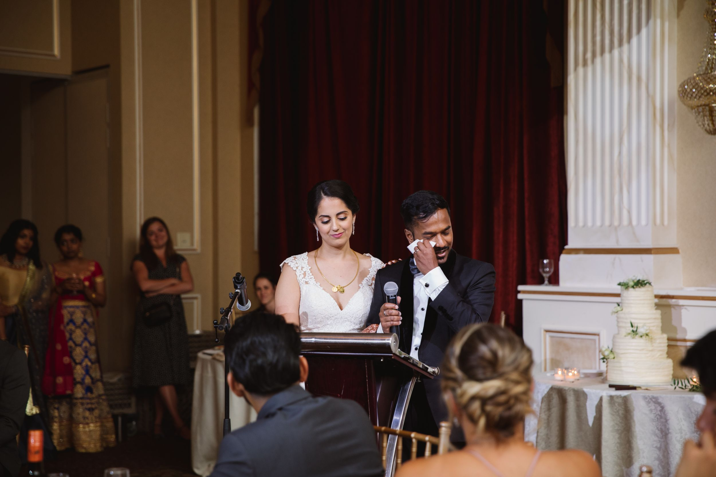 groom crying during speech at wedding reception