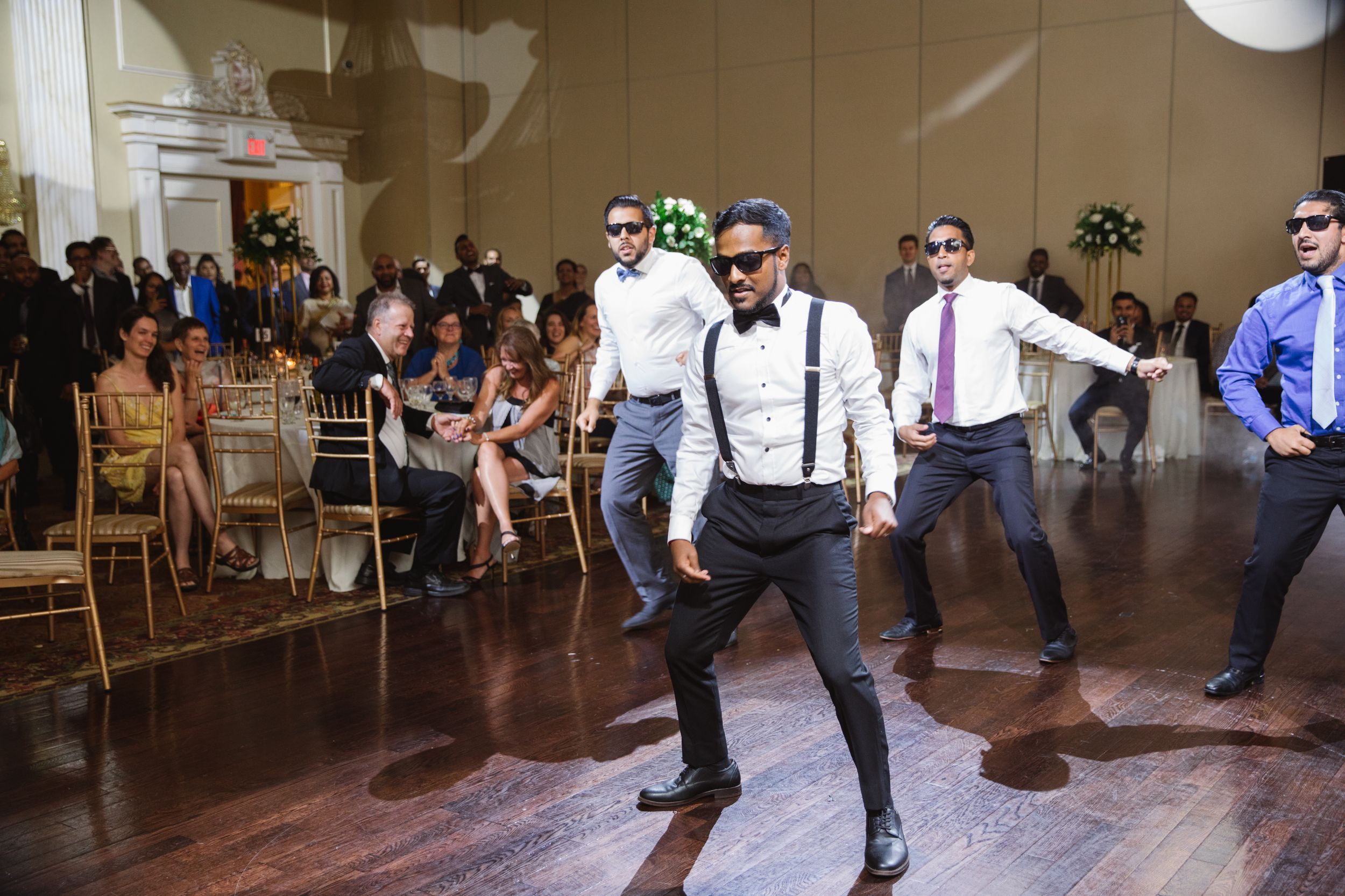 groom dancing with groomsmen and sunglasses