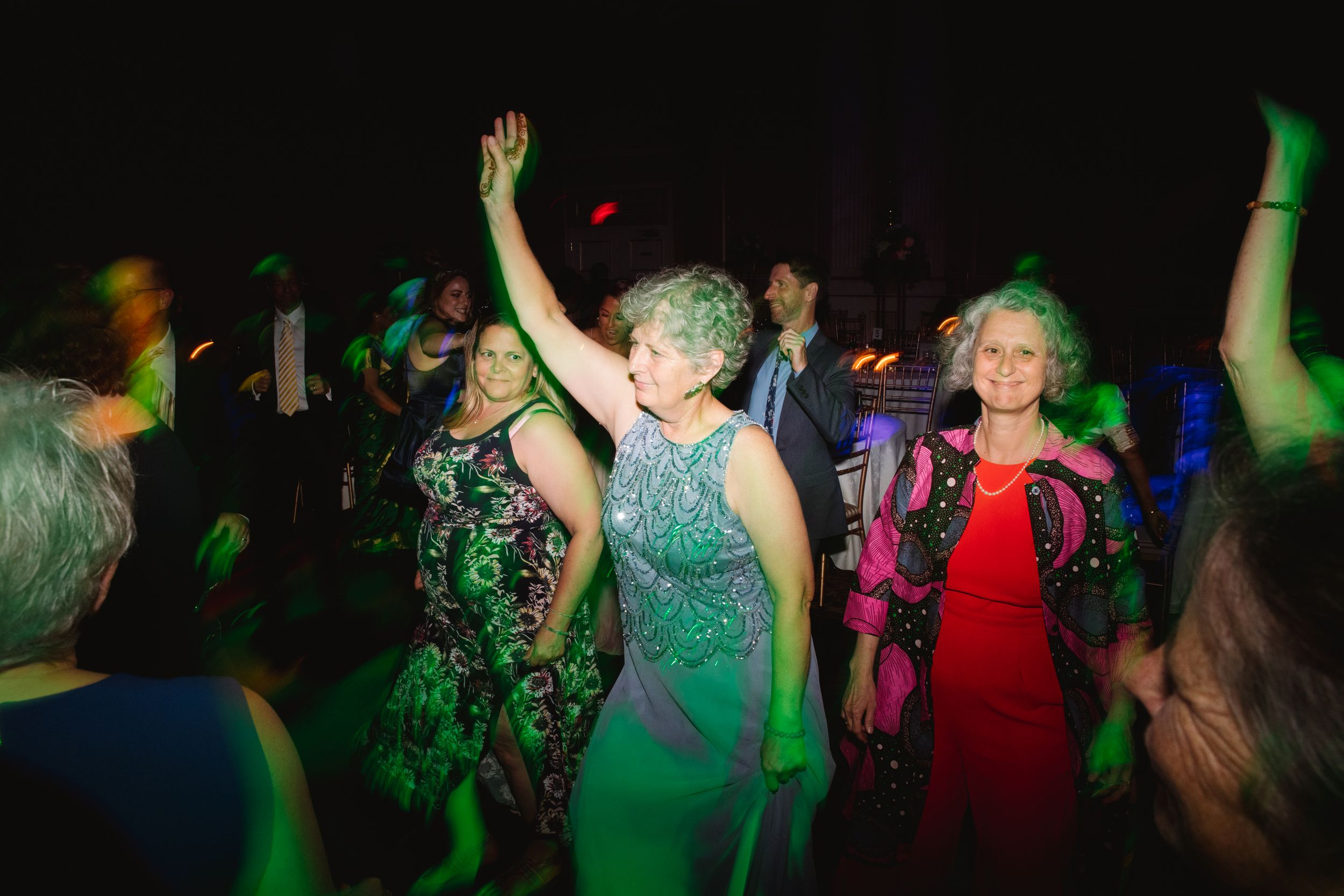 mother of bride dancing during reception hand up in the air