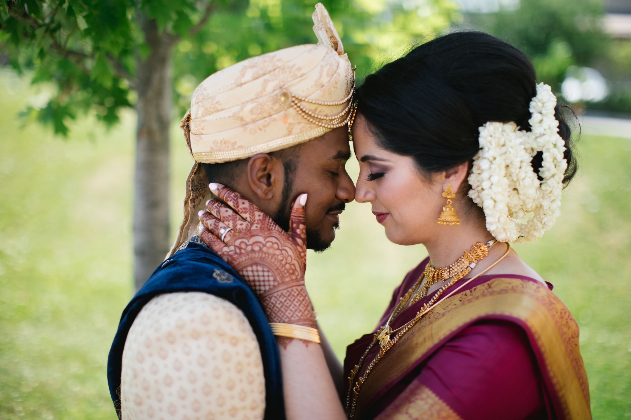 bride and groom outside hindu mehndi