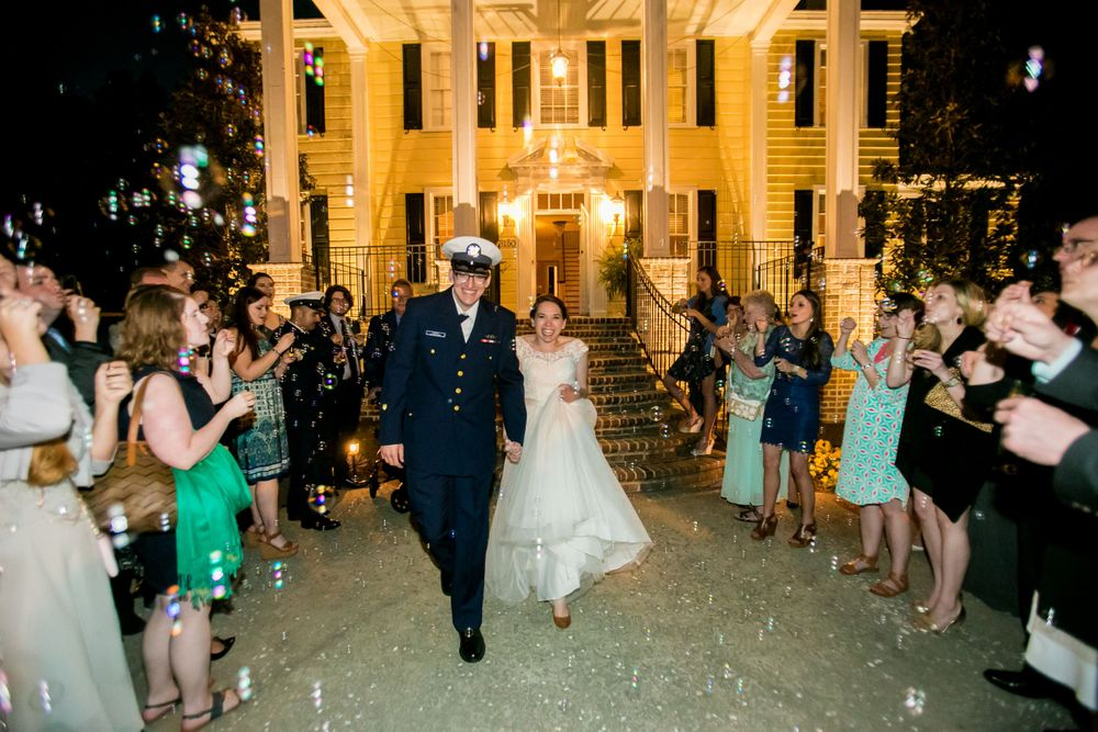 Bride Natalie and groom Ross make their sparkler exit following their wedding at the Springdale House in Springdale, SC