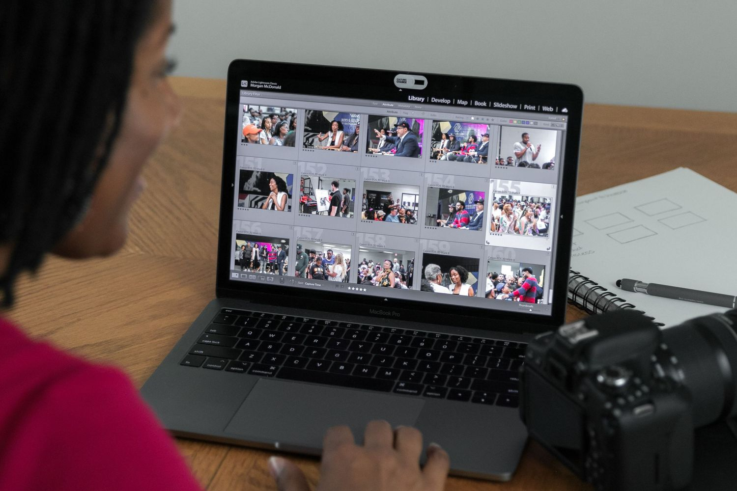 Image of RED by Morgan owner and photographer reviewing images for a client on a laptop.
