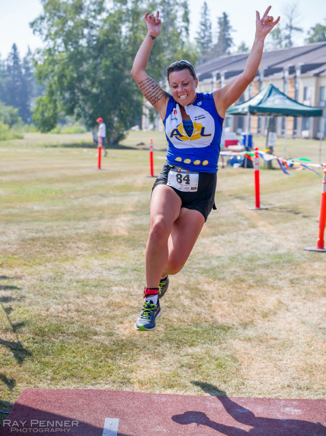 triathlon girl at finish line hands in air Hecla Manitoba Ray Penner Photography