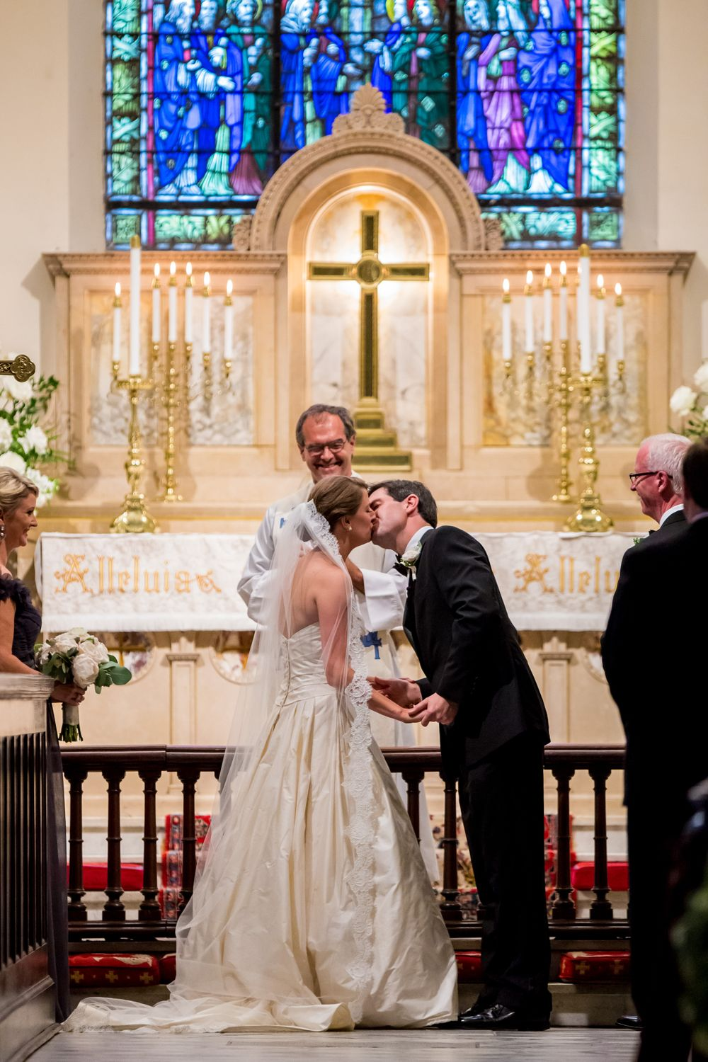 Ashley & Ben have their first kiss during their wedding at St. Philips Church in Charleston, SC