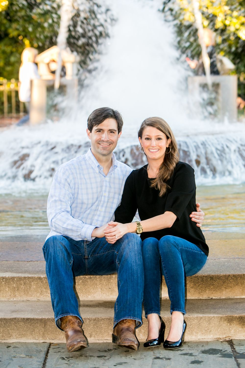 Ashley and Ben's engagement portrait in front of the fountain at Waterfront Park in Charleston, SC