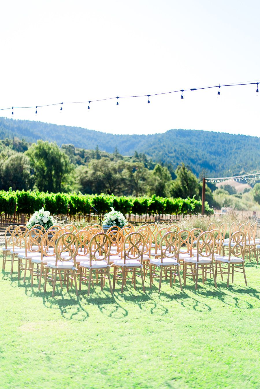 wooden chairs set up for ceremony at outdoor wedding at Pennyroyal Farm in Northern California