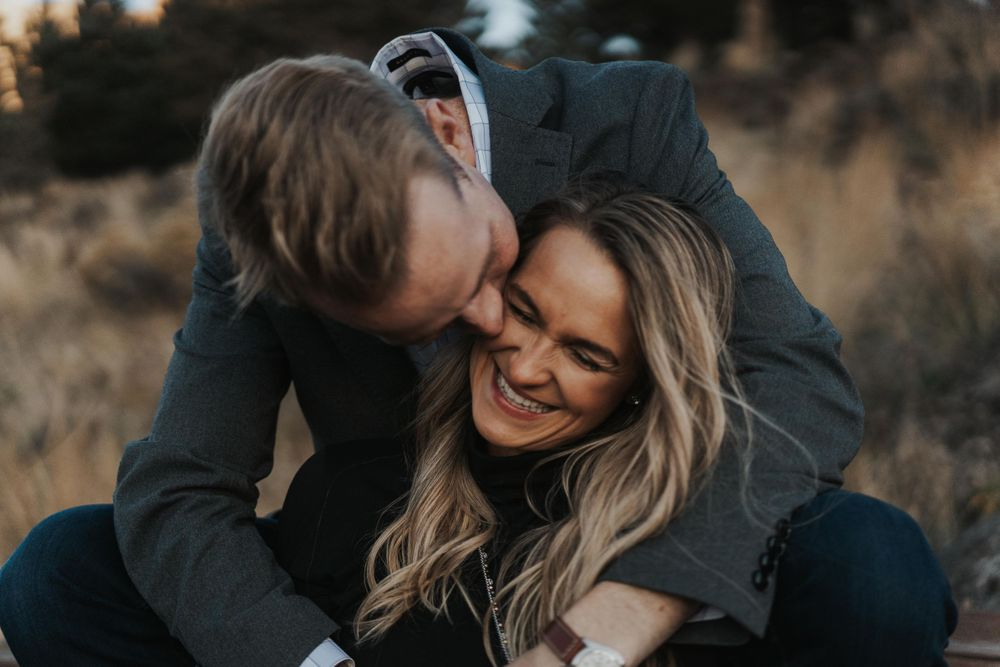 Photo by Kelsie Burke Photography of the couple laughing together in Smith Rock State Park
