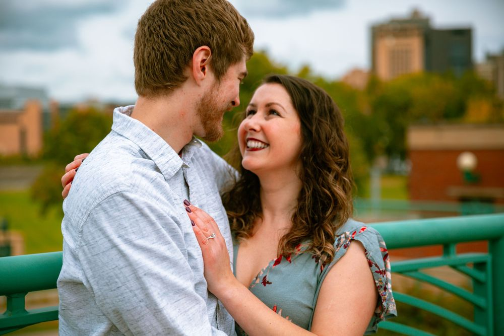smiling woman stares into fiancé's eyes