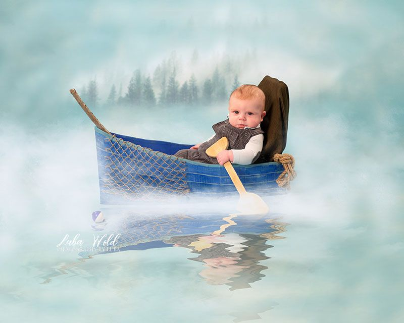 three months boy fisherman in a blue boat studio portrait by Coeur d alene photographer luba wold